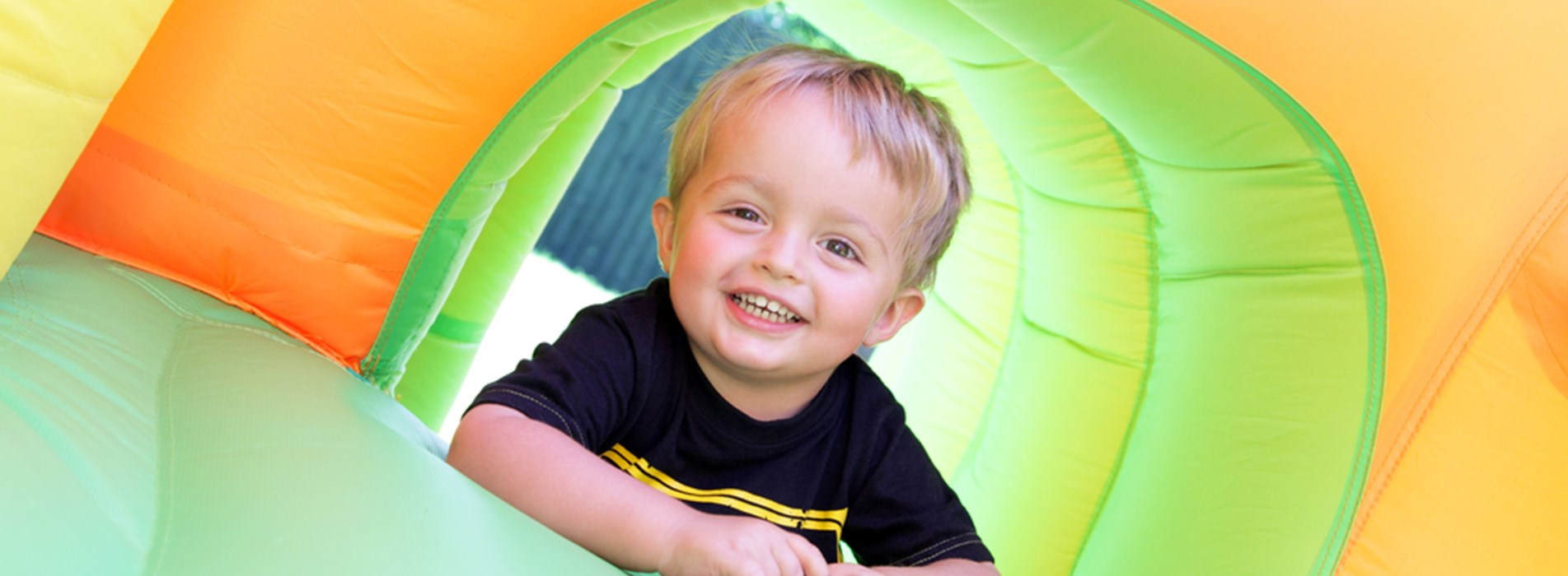 Child in Bouncy Castle